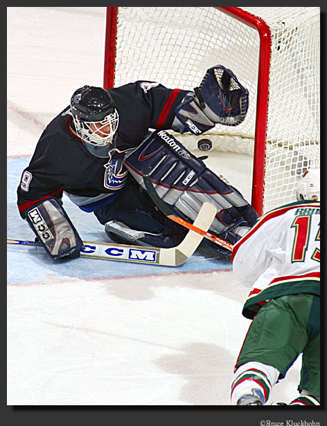 photo of Andrew Brunette scoring a goal against Cloutier in the playoffs.